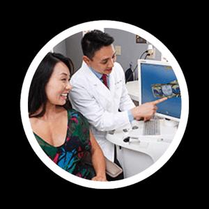 patient looking at dental screen